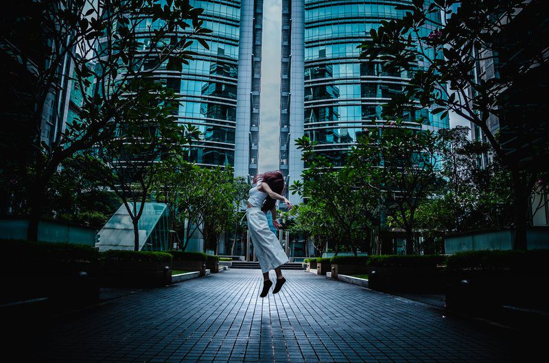 On Sunday, I was exploring my girlfriend's workplace business centre in Bangsar South City, Kuala Lumpur. Come to my surprise there was nobody in the area and I have my camera with me back in my car. The idea of the photo was initially making her looked like she is dancing in the sky, it was until she was starting to land on the ground I took another chance to take another picture. I find it looked like she is floating in the air, took some edit and this seems to be the best photo I took.